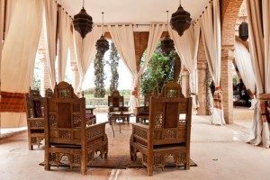Arabian Riad Tent furnished with traditional furniture and carpet for a Wedding.
